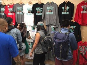 Shoppers check out the merchandise at Vancity Original's Grizzlies pop-up shop on Friday, Sept. 28, 2018.