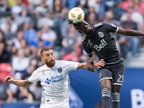 Vancouver Whitecaps' Kei Kamara (23) gets his head on the ball above San Jose Earthquakes' Guram Kashia during the first half of an MLS soccer game in Vancouver, on Saturday September 1, 2018.