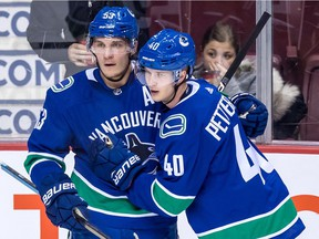 Bo Horvat (left) and rookie Elias Pettersson will be counted on to provide some scoring punch this season for the Vancouver Canucks, especially on the power play.