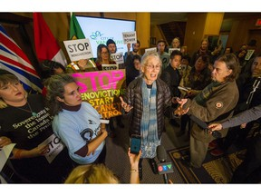 Coun. Jean Swanson speaks as hundreds attend a rally against renovictions before a council vote at Vancouver City on Dec. 4.