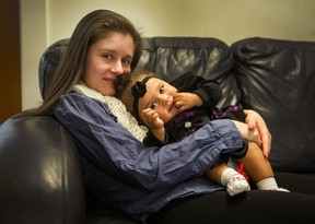 Amber Hawse, 20, with nine-month-old daughter Delilah at Aunt Leah's in New Westminster.