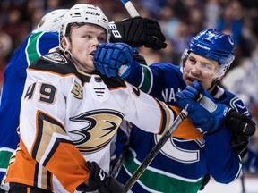 Former minor-league teammates Max Jones and Luke Schenn (right) get reunited during a Feb. 25, 2019 NHL game at Rogers Arena.