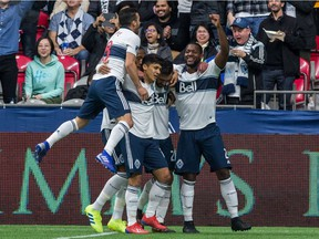 Vancouver Whitecaps' Erik Godoy, centre, celebrates his goal with teammates, from left, Felipe, Fredy Montero and Doneil Henry during the first half of their March 2 season opener against Minnesota United at B.C. Place Stadium.