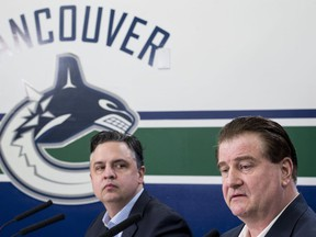 Vancouver Canucks general manager Jim Benning, right, and head coach Travis Green pause for a moment during a news conference at Rogers Arena in Vancouver on Monday, April 8, 2019. The Canucks finished their season this past weekend failing to make the 2019 playoffs.