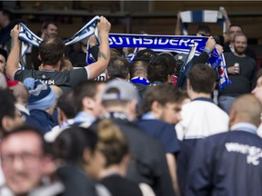 Vancouver Whitecaps FC fans walk out of the match between Vancouver and Los Angles Football Club during the first half.