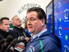 Vancouver Canucks' general manager Jim Benning speaks to media during a press conference at Rogers Arena in March this year.