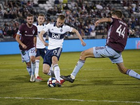 Vancouver Whitecaps midfielder Andy Rose scores the game-winning goal as Colorado Rapids' Deklan Wynne (left) and Axel Sjoberg (44) defend during the second half of their MLS game on Friday, May 3, 2019 in Commerce City, Colo.