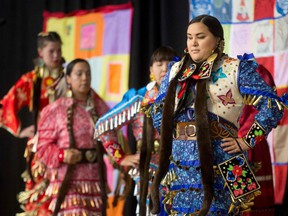 Jingle Dancers perform at the closing ceremony marking the conclusion of the National Inquiry into Missing and Murdered Indigenous Women and Girls at the Museum of History in Gatineau, Quebec on June 3, 2019.