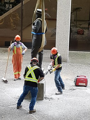 The controversial statue of Judge Begbie outside the Law Courts in New Westminster was removed Saturday, July 7. Picture credit: Matt Flemming, special to Postmedia News. [PNG Merlin Archive]