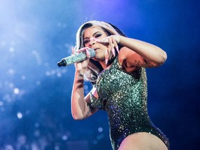 American rapper Cardi B performs during the Roskilde Festival on July 4, 2019 in Roskilde, Denmark.