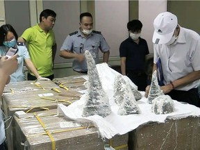 This picture from the Vietnam News Agency taken on July 25 shows customs officials at Noi Bai International Airport removing smuggled rhino horn pieces from packaging in Hanoi. Fifty-five pieces of rhino horn were found encased in plaster casts at an airport in the Vietnamese capital, authorities said on July 28, as the country tries to crack down on sophisticated wildlife smuggling routes.