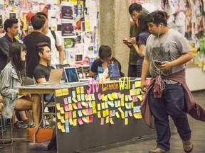 Wednesday's temporary Lennon Wall at Simon Fraser University, staffed by students.