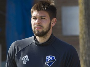 Current Whitecaps goalkeeper Maxime Crépeau heads to a training session with the Montreal Impact in 2016.