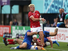 DTH Van Der Merwe of Canada breaks tthrough the Italy defence during the Rugby World Cup 2019 Group B game between Italy and Canada at Fukuoka Hakatanomori Stadium on September 26, 2019 in Fukuoka, Japan.