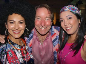 Staffers Tamila Khayrullaeva, James Cooper and Mary Lam orchestrated the '70s theme fundraiser. Photo: Fred Lee.