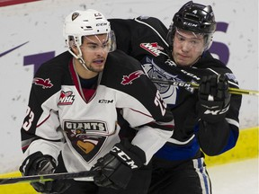 Veteran Jadon Joseph of the Vancouver Giants, left, has been dealt to the Moose Jaw Warriors as the WHL squad trims its overage numbers. The Giants still have five 20 year olds on the roster and must get down to three. Their regular season starts Friday in Prince George.