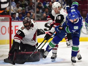 Vancouver Canucks forward Michael Ferland (79) shoots the puck against Arizona Coyotes goaltender Adin Hill (31) and forward Christian Dvorak (18) during the first period at Rogers Arena.