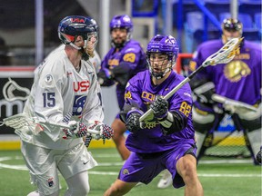 Joe Resetarits of the United States, left, is closely covered by Brayden Hill of the Iroquois Nationals during World Indoor Lacrosse Championship action at Langley Events Centre.