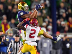 Notre Dame Fighting Irish wide-receiver Chase Claypool catches a pass as USC Trojans cornerback Olaijah Griffin defends at Notre Dame Stadium on Oct. 12.