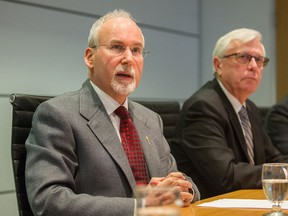 FILE PHOTO: Gary Lenz (left) and Craig James speak at Fasken Martineau DuMoulin LLP in Vancouver, BC, Nov. 26, 2018.