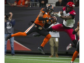 BC Lions  T.J. Lee intercepts a pass intended for Calgary Stampeders Hergy Mayala at BC Place Nov. 2.