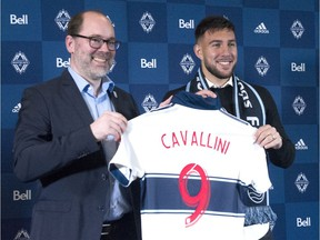 Vancouver Whitecaps sporting director Axel Schuster welcomes the team's newest signing, Canadian striker Lucas Cavallini, at a 2019 news conference. The biggest signing in Caps history came a month after Schuster was hired as director.
