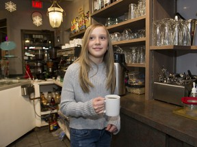 Gia Carella serves a coffee at the Cozmos Cafe in Burnaby.