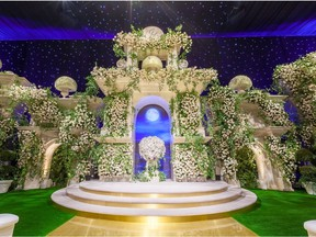 A grand wedding altar with floral art by Mark's Garden.