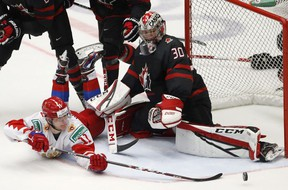 Russia's Vasili Podkolzin, left, fails to score past Canada's goaltender Joel Hofer, right, during the U20 Ice Hockey Worlds gold medal match between Canada and Russia in Ostrava, Czech Republic, Sunday, Jan. 5, 2020.