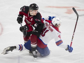 Vancouver Giants' star defenceman Bowen Byram, left, will be relied on in the WHL's stretch drive toward the playoffs.