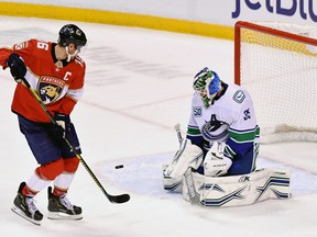 Vancouver Canucks goaltender Thatcher Demko (35) blocks a shot by Florida Panthers center Aleksander Barkov (16) during the second period at BB&T Center.