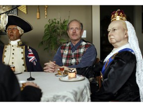 Ken Lane, the former owner of the Royal London Wax Museum, poses with Queen Victoria and Capt. Cook.