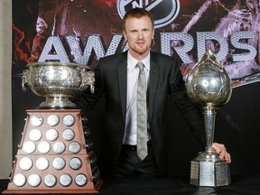 Henrik Sedin, in 2009-10, has the single biggest haul of NHL hardware the Canucks franchise had ever seen, as he picked up the Art Ross Trophy (left) as the league's leading scorer at the Hart Memorial Trophy (right) as its most valuable player.