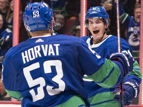 Loui Eriksson of the Vancouver Canucks celebrates with teammate Bo Horvat after scoring against the Boston Bruins during NHL action at Rogers Arena on Feb. 22 in Vancouver.