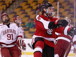 Adam Gaudette of Northeastern University reacts after scoring against Harvard University during the Beanpot Tournament consolation game at TD Garden on Feb. 8, 2016, in Boston.