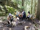 Outdoor enthusiasts have been critical about the amount of funding allocated for trail maintenance in B.C., as well as the amount of time it takes for new trails to be approved. Hikers heading to Dog Mountain pass those returning in this file photo from 2019.