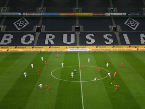 An overview shows the empty stadium during the German first division Bundesliga football match Borussia Moenchengladbach v 1 FC Cologne in Moenchengladbach, western Germany on March 11, 2020. - Rhine Bundesliga derby between Borussia Moenchengladbach and Cologne, will be held behind closed doors due to the coronavirus, the first game in Bundesliga history to be played without fans.