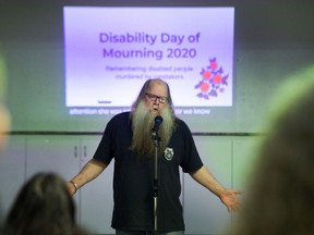 Abuse victim Bill MacArthur speaks during Eighth annual Disability Day of Mourning at Burnaby Neighbourhood House on Sunday.