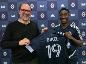 Vancouver Whitecaps sporting director Axel Schuster stands with new signee Janio Bikel at the team's training facility on Tuesday.