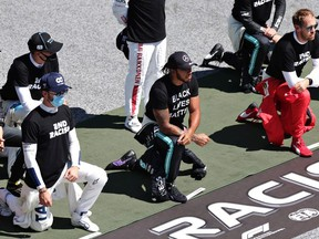 Lewis Hamilton of Great Britain and Mercedes GP, Pierre Gasly of France and Scuderia AlphaTauri and some of the F1 drivers take a knee on the grid in support of the Black Lives Matter movement ahead of the Formula One Grand Prix of Austria at Red Bull Ring on July 05, 2020 in Spielberg, Austria.