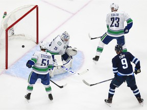 Jacob Markstrom allows a second period goal to Dmitry Kulikov of the Winnipeg Jets (not pictured).
