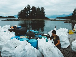 Lilly Woodbury, a spokesperson for the Surfrider Foundation Canada, works to clean up plastic garbage in the ocean. The foundation and other environmental groups are worried the pandemic has caused a huge setback in getting rid of single-use plastics.
