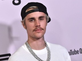 """In this file photo Canadian singer Justin Bieber arrives for YouTube Originals' """"Justin Bieber: Seasons"""" premiere at the Regency Bruin Theatre in Los Angeles on January 27, 2020."""