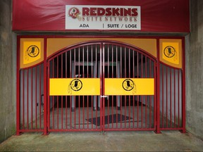 The NFL's Washington Redskin's logo is stamped in a steel gate at FedEx Field July 13, 2020 in Landover, Maryland.