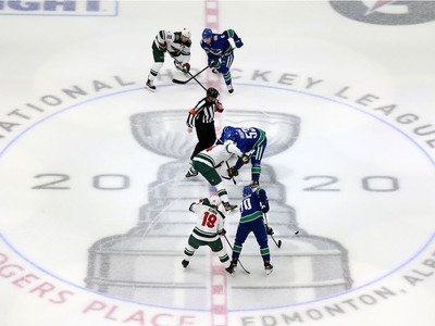 The  Minnesota Wild and the Vancouver Canucks face off in Game One of the Western Conference Qualification Round prior to the 2020 NHL Stanley Cup Playoffs at Rogers Place on August 02, 2020 in Edmonton, Alberta, Canada.
