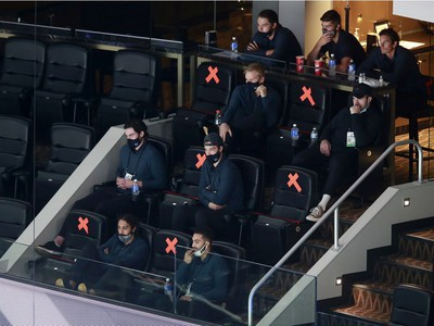 The Vancouver Canucks scratched teammates sit in the stands in Game One of the Western Conference Qualification Round prior to the 2020 NHL Stanley Cup Playoffs at Rogers Place on August 02, 2020 in Edmonton, Alberta, Canada.