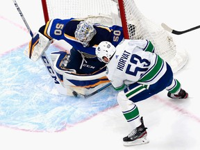 Jordan Binnington of the St. Louis Blues makes a first period stop on Bo Horvat of the Vancouver Canucks in Game One of the Western Conference First Round during the 2020 NHL Stanley Cup Playoffs at Rogers Place on Aug. 12, 2020 in Edmonton.