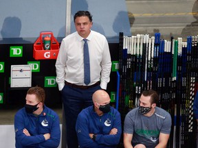 Coach Travis Green of the Vancouver Canucks, along with his staff and players, have been safe in the Rogers Place bubble during the NHL post-season in Edmonton. What will be interesting to watch is how the NHL stickhandles around COVID-19 issues next season.