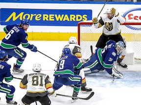 Shea Theodore of the Vegas Golden Knights gets in behind Thatcher Demko of the Vancouver Canucks in the second period.