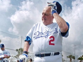 Tommy Lasorda of the Los Angeles Dodgers readjusts his cap during a practice session at their spring training centre in Vero Beach, Fla., in February 2005.
